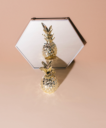 Tropical golden Pineapple on beige background.