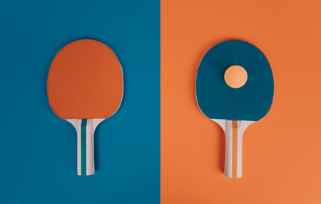 Table tennis or ping pong rackets and ball on a color background. Stock Photo