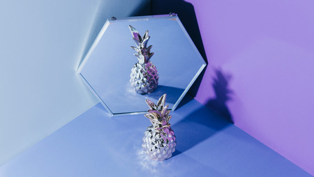 Tropical golden Pineapple on ultraviolet background.