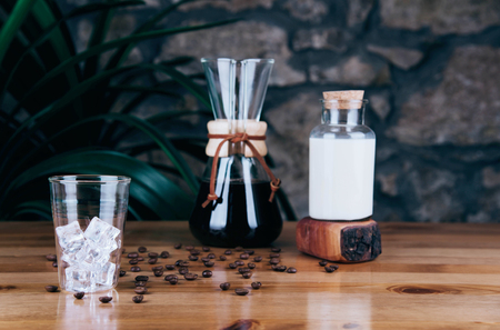Cold brew iced coffee in glass and coffee beans on trendy background. Kho ảnh