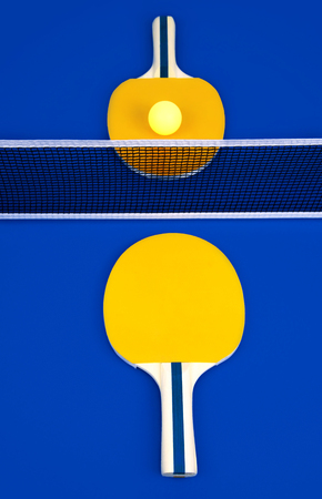 Table tennis   rackets and ball on a blue table. Kho ảnh