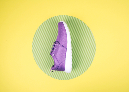 Lilac sneakers on a multi colored pastel surface. Top view, Fashion style. Kho ảnh