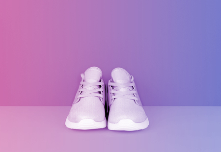 Shot of sneakers in vibrant gradient holographic colors. Stylish healthy lifestyle concept.