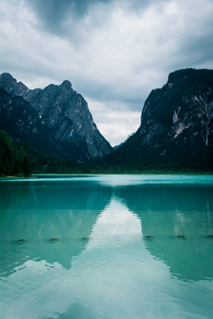 Dobbiaco Lake in the Dolomites Alps, summer landscape, Bolzano, Italy.
