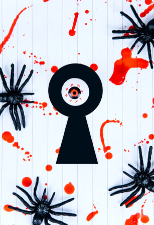 Black spiders and keyhole on a white background covered with blood, Halloween. Kho ảnh