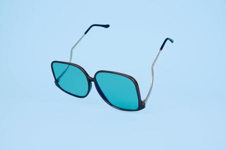 Retro sunglasses on minimal bright background. Summer concept. Stock Photo
