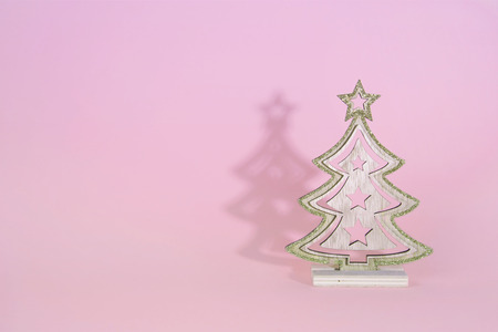 Christmas wooden tree over light blue background. Xmas and holiday concept.