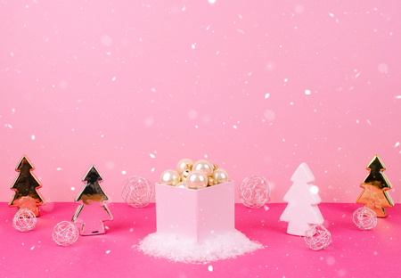 Christmas tree balls on a pink background with a place for your text.