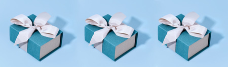 Pattern made of blue gift boxes on pastel background. Stock Photo