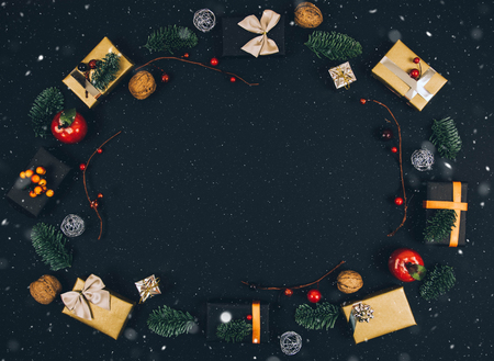 Christmas new year black stylish background and frame with gifts. Top view. Stock Photo