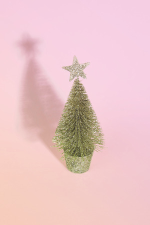 Christmas tree over light blue background. Xmas and holiday concept.