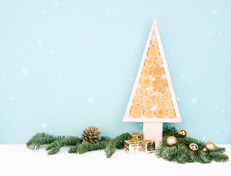 Christmas wooden tree over dark light blue background. Eco style with space for your text.