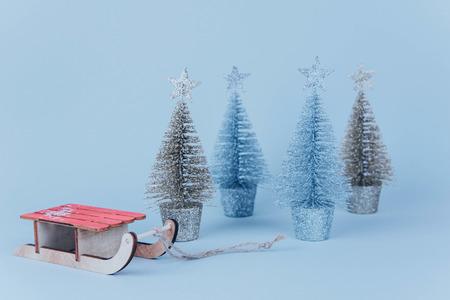 Stylish vintage wooden sled on bright background.