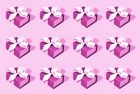 Pattern made of pink gift boxes on pastel background. Stock Photo