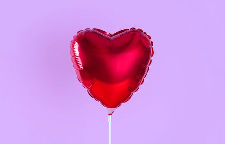 Red heart balloon isolated on white background. Creative minimal love concept. 写真素材