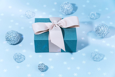 Blue gift boxe with Silver shiny Christmas bauble decoration. Xmas ans holiday concept.