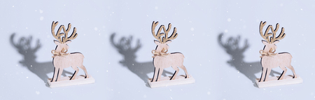 Cute reindeer chrismas decoration on bright background. Xmas and holiday concept.