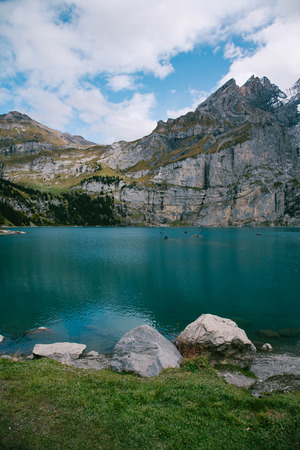 View of Oeschinen Lake in the Swiss alps with beautiful turquoise water. Nature and travel concepts.