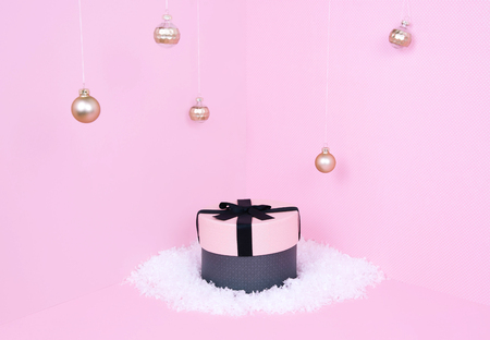 Pink gift box on pastel background. Xmas and holiday concept
