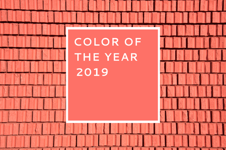 Brick wall texture as a background. Color of the year 2019.