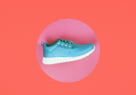 Lilac sneakers on a multi Living Coral background. Color of the year 2019. Stock Photo