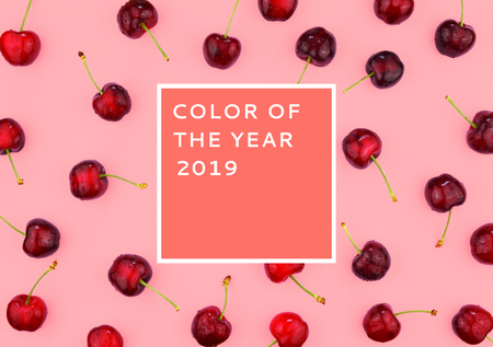 Ripe red sweet cherries on trendy background. Flat lay style. Color of the year 2019. Stock Photo