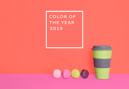 Cup of coffee to go with macarons on trendy background. Color of the year 2019.