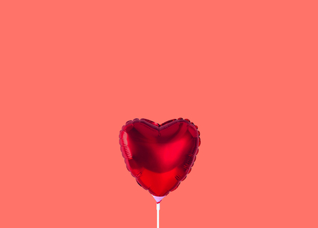Red heart balloon isolated on trendy background. Color of the year 2019. Stock Photo