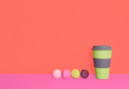 Cup of coffee to go with macaron with place for your text. Color of the year 2019.