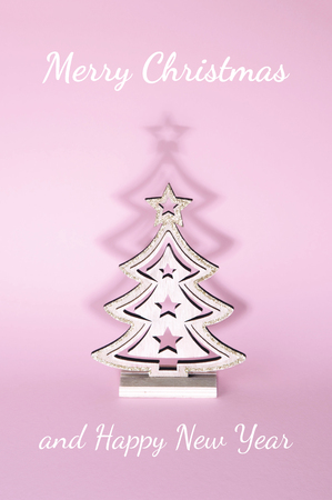 Christmas tree over pink background. Xmas and holiday concept.