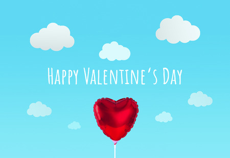Red heart balloon on blue sky background. Creative minimal love concept. Stock Photo