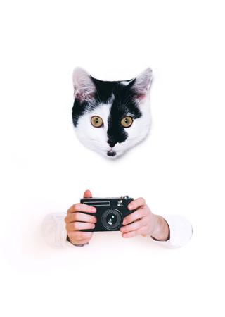 Hands holding retro camera, close up on white background.