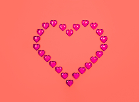 Red heart against yellow background. Valentine s day theme with copy space.