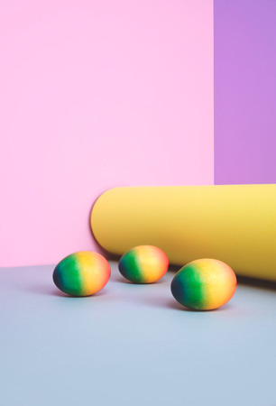 Painted eggs on pastel background. Creative minimal concept.