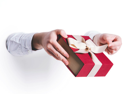 Man holding a gift box on white background.