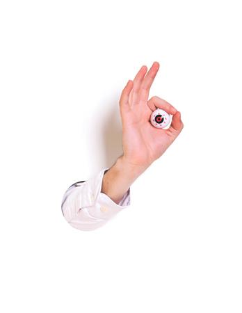 Hand ok sign on white background. Creative minimal concept.