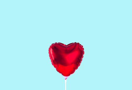 Red heart balloon isolated on trendy background.