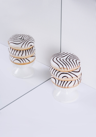 Striped donuts on a white background. Stylish minimal concept Stock Photo