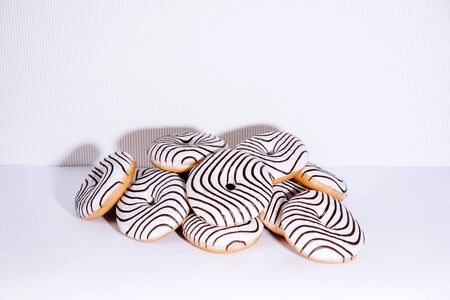 Striped donuts on a white background. Stylish minimal concept 스톡 콘텐츠