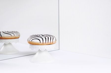 Striped donuts on a white background. Stylish minimal concept Zdjęcie Seryjne