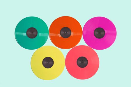 Colored vinyl records collection on a light background with copy space. Top view. Zdjęcie Seryjne