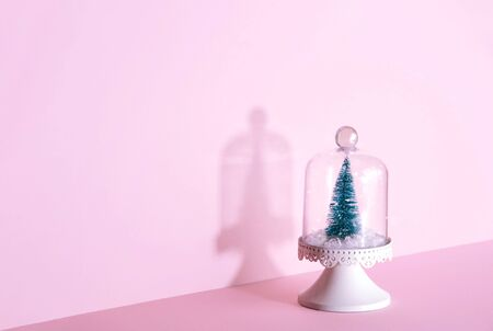 Creative Christmas design on pink pastel color background with Christmas tree. Xmas and holiday concept.