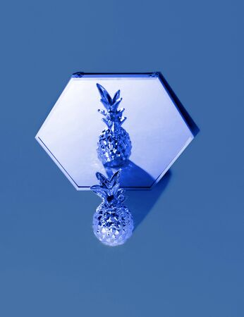 Tropical golden Pineapple on classic blue background. Trendy color 2020. Zdjęcie Seryjne