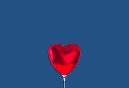 Red heart balloon isolated on trendy background. Color of the year 2019. Zdjęcie Seryjne