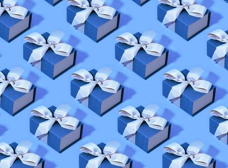 Pattern made of blue gift boxes on pastel background. Trendy color