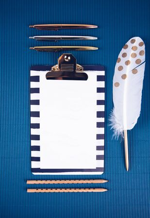 School supplies on a blue background. Trendy color. Overhead shoot. Zdjęcie Seryjne