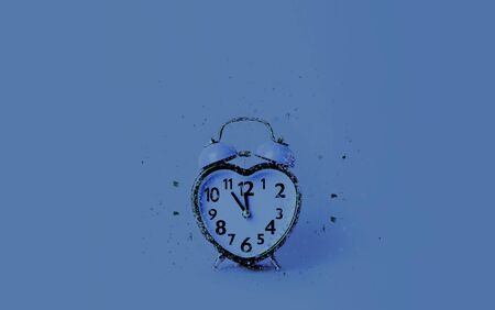 Heart shaped clock on blue background. Valentines day and love and duration concept.