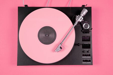 Colored vinyl record on a pink background with copy space. Top view. Stok Fotoğraf