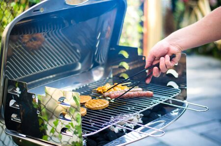 nice barbeque during the summer with friends and lots of meat Stock Photo