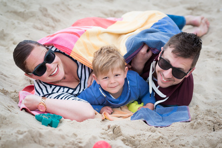 happy family on the beach during the summer holidays